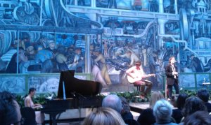 Jesse, Jackson and Patti Smith at Detroit Institute of Arts with Diego Rivera's fresco as a backdrop.