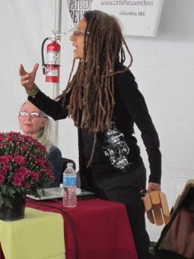 Linda Joy Burke conducting the audience/musicians. (Photo: Laura Shovan)
