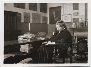 Gertrude Stein in her salon, writing, c. 1920, Photograph by Man Ray, from Gertrude Stein and Alice B. Toklas Papers, Yale Collection of American Literature.