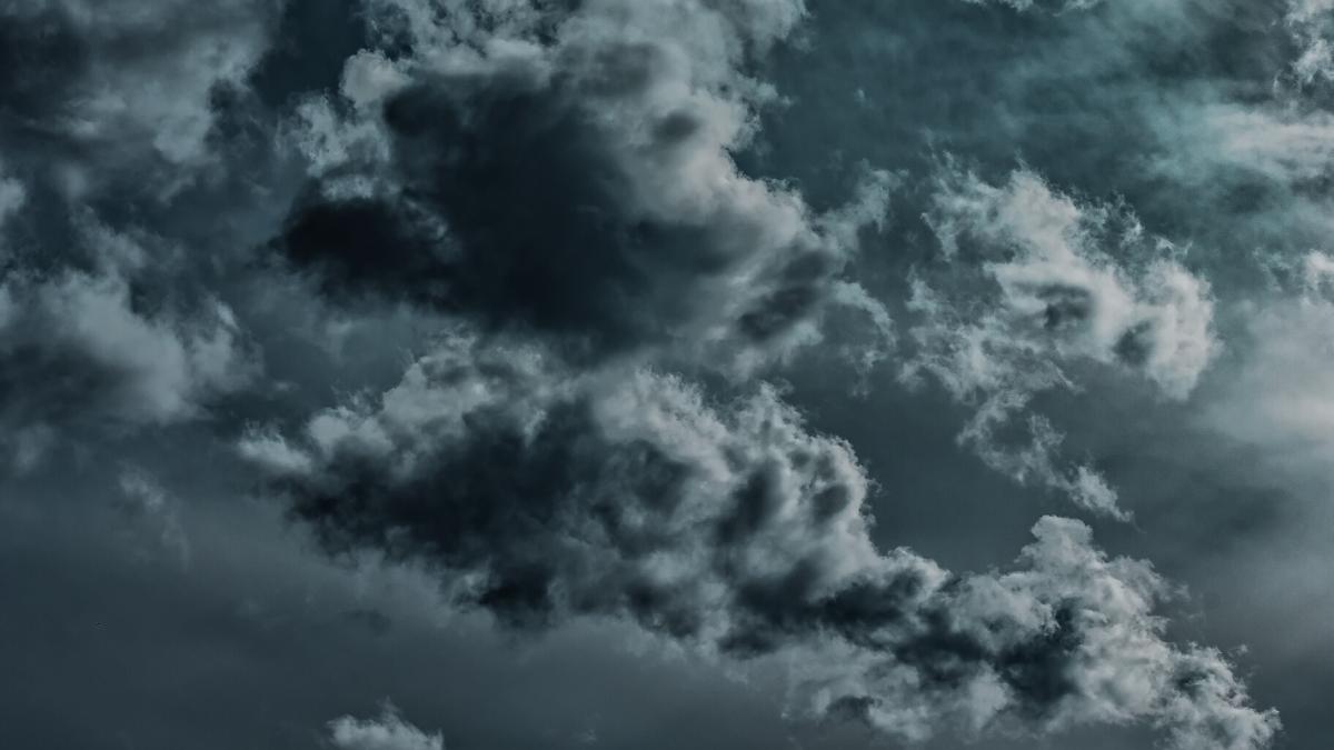 Grey rain clouds gather in the sky