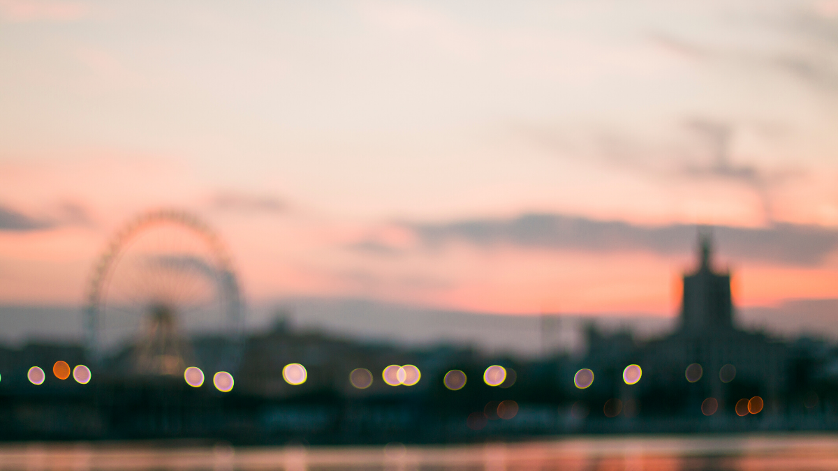 Out-of-focus image of the London Eye and the River Thames at dusk